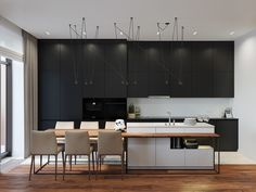 Black panelled cabinetry magnetised hanging lights kitchen