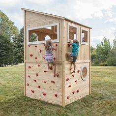 Kids climbing the outside of wooden cedar playhouse #buildplayhouses #playhousebuildingplans