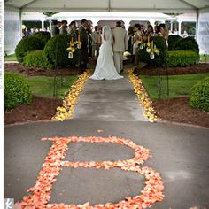If we do the wedding outside, then we can have lots of fun with the set up.  Like this is a flower petal lined aisle.  We can ditch or keep the initial.  But its a fun idea that we wouldn't be able to do indoors.