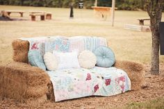 Sofa made of hay covered with fluffy pillows and a quilt as a resting spot for guests during Southern rustic chic wedding   Photo: Pap...