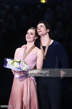 Tessa Virtue and Scott Moir of Canada look on in...