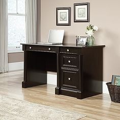 Large drawer/shelf features flip-down panel for keyboard/mouse. Two small drawers with metal runners and safety stops. Lower drawer with full extension slides holds letter-size hanging files. Quick and easy assembly with patented T-slot drawer system. Wind Oak finish.
