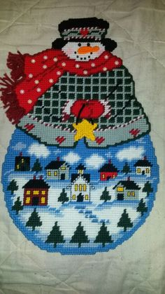 Snowman with village Plastic Canvas Ornaments, Plastic Canvas Crafts, Plastic Canvas Patterns, Snowman Crafts, Xmas Crafts, Christmas Wall Hangings, Plastic Canvas Christmas, Fabric Journals, Christmas Cross