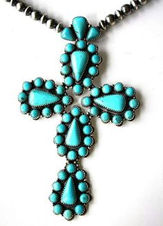 Huge turquoise and pearl cross btw Gene Boyd