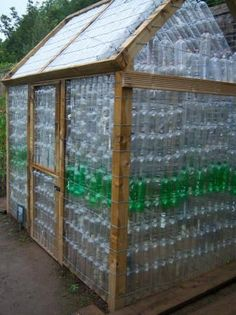 Upcycled bottle greenhouse. (have I pinned this before?)