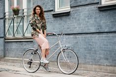 Camo print jacket, pink pleated skirt & grey trainers | @styleminimalism