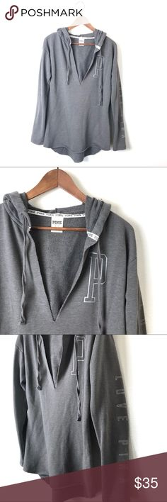 "PINK Gray V-Neck Slit Hoodie Sweatshirt PINK Gray V-Neck Slit Hoodie Sweatshirt. 29"" long. 19"" across the bust. 60% Cotton 40% Polyester. Light weight sweatshirt. Raw edge hem. Light piling otherwise in great condition. Size S. PINK Victoria's Secret Tops Sweatshirts & Hoodies"