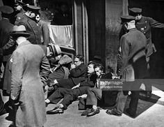 Lying on the street are some of the injured workers after men armed with guns, knives, and lead pipes raided a meeting of the Needle Trade Workers on West 26th Street, leaving one dead and sixteen injured, New York, New York, April 27, 1933.