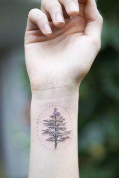 A Tree Wrist Elegant Tattoos Represent Lotus Flower Tattoo Wrist, Mandala Wrist Tattoo, Wrist Henna, Cross Tattoo On Wrist, Bird Tattoo Wrist, Name Tattoos On Wrist, Meaningful Wrist Tattoos, Wrist Tattoos For Women, Small Wrist Tattoos