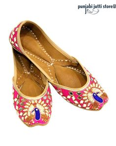 Pink Silk Base with Hand Embroidered Peacock the Paradise Bird with Thread and Stone, Gracing with Mirror Work. These Punjabi jutti's are so Elegant Hand Crafted In Soft Pure Leather On The Front And The Back Of The Heel. It Has Been Cushioned At The Sole For Comfort. #Punjabijuttistore #Punjabijutti #mojari #womenpunjabijutti #jutti #menpunjabijutti #khussa #bridetobe #indianbride #wedding #wedeliver #worldwide
