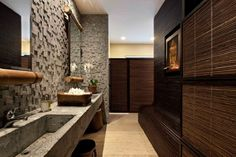 Use mix of natural materials to improve the look of asian style bathroom finishing touches with Woven boxes and cultural art also live orchid flower