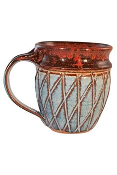 """This barrel mug with cross hatch design is hand thrown and glazed from a small potters studio in Freeville NY. Lead free microwave and dishwasher safe. Measures 4"""" high and 3"""" wide. Holds 10-12 oz. Please Note: Each item is hand crafted and will vary slightly from the photo.  Cross Hatch Mug by Artifacts Gallery. Home & Gifts - Home Decor - Dining Ohio"""