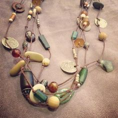 amber, silver, ottoman coins, roman glass beads and pebbles