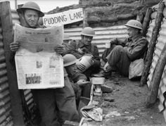 British Army in France 1940 (F 3551) Men of the 1st Queen's Own Royal West Kent Regiment enjoy a tot of rum in a section of trench named 'Pudding Lane', 4th Division near Roubaix, 3 April 1940.