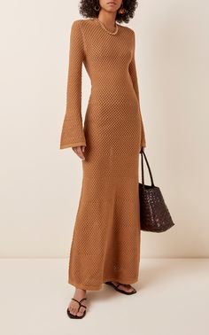 DoDo Bar Or's 'Liz' maxi dress is the perfect addition to your holiday collection. Crafted from breathable cotton, its crochet knit silhouette is designed with bell sleeves, maxi hemline and eye-catching open back. Complement its laid-back style with nude undergarments and a wide-brim hat for an effortlessly chic look.