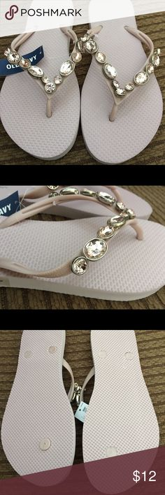 Old Navy Jeweled lavender Flip Flops This is a brand-new pair of Old Navy lavender flip-flops with lavender pink jewels set into the top. This is a very rich pink lavender color that doesn't come across very well in the photos. The color is much more beautiful in person! Ladies size 8. Old Navy Shoes Sandals