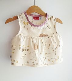 A new top for a sweet little girl! ~ Japanese cotton fabric ~ Contrasting pink spotted neckline ~ Press studs to shoulder and side for easy