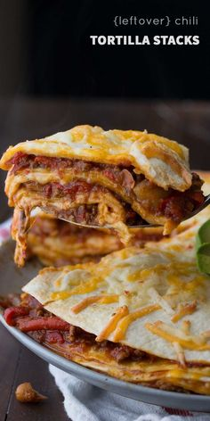 A fast and easy tortilla stack recipe that spreads leftover chili between tortillas with cheese. Ready in 25 minutes, and makes for an awesome weeknight dinner and packed lunch the next day! Leftover Chili Recipes, Leftovers Recipes, Slow Cooker Recipes, Crockpot Recipes, Cooking Recipes, Easy Recipes, Hamburger Recipes, Supper Recipes, Healthy Recipes