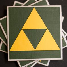 Help Link in his quest to save Princess Zelda by hiding the Triforce from the evil Ganon!    Ceramic coasters measure 4.25in x 4.25in  The designs are