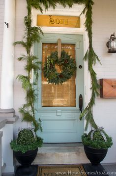 Get your home ready for Christmas with these 25 Christmas Porch Decorating Ideas. Beautiful Christmas porch ideas that are simple and budget friendly! Christmas Greenery, Christmas Porch, Outdoor Christmas Decorations, Christmas Fun, Christmas Wreaths, Xmas, Christmas Island, Christmas Cactus, Christmas Lights