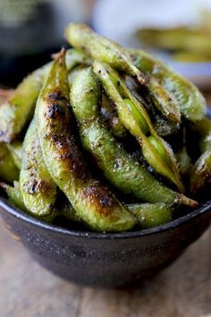 A nutty and healthy snack of edamame lightly fried in toasted sesame oil, tossed with black pepper and soy sauce.