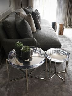 Wonderful side tables in acrylic at a Swiss Chalet by Kelly Hoppen.