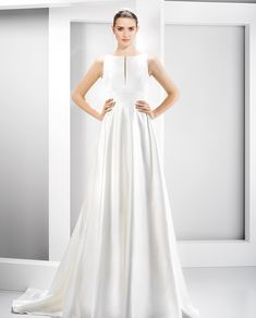 6039 wedding dress from Jesus Peiro wedding dresses Nanda Devi Collection - Sleek wedding dress with contemporary neckline - see the rest of the collection on www.onefabday.com