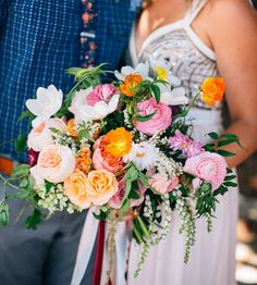 spring rustic bouquet of ranunculus, poppies, garden roses and tulips