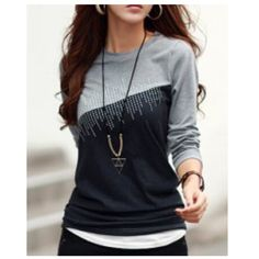 NWOT jewel neck long sleeve colored jeweled shirt NWOT jewel neck long sleeve shirt. Grey and black with colored jewels. Material is cotton blend. Size medium, arm length is 53 cm, shoulder width is 35 cm, and length is 55 cm Pictures from seller Boutique Tops Tees - Long Sleeve