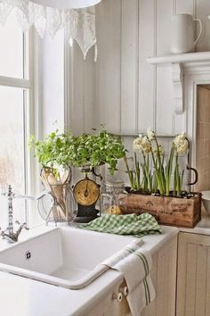 The creams and fresh greens, the metal scale, and the bright, wide window. Love!