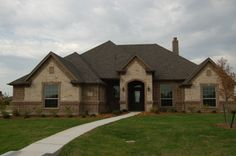 Front Elevation- brick and stone   #mcbeehomes #newhomeconstruction