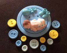 Fondant baby boy inside angel wings cake by evynisscaketopper
