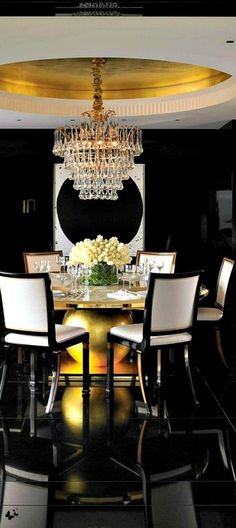 Art Deco Dining Room with Concrete floors, Chandelier, MS International Absolute Black Granite Tile
