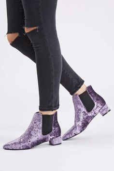 Get the luxe look in these lilac velvet Chelsea boots, featuring a small heel and pointy toe. We'd style with slim fit jeans and a duster coat for a chic finish.