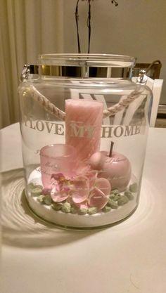 Windlicht met roze deco en kaarsen