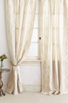 Ooooo modern version of the ol lace curtain. hot damn.....  Appliqued Lace Curtain - anthropologie.com