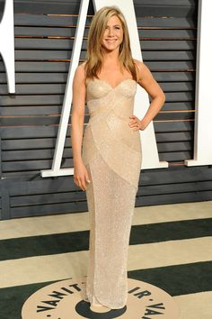 Jennifer Aniston didn't switch out of her Versace gown at the Vanity Fair bash.