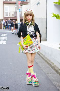 Moriya Kuma in Harajuku with fashion from Goocy along with a hand painted clutch and painted Buffalo platforms.