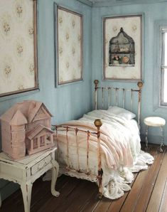 Dollhouse bedroom with a messy, unmade bed and a dollhouse of their own!