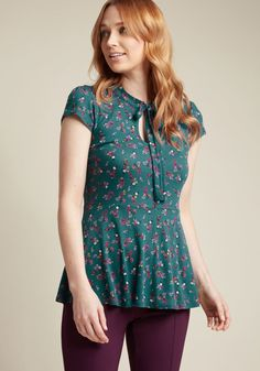 Feeling Feminine Knit Top in Teal Floral - Are you up for a look that's enlivened with flirty detailing and fun florals? Then turn your attention to this green top from our ModCloth namesake label! Between the lightly puffed shoulders of this knit number is a tied neckline, situated elegantly atop its peplum waist. Pretty, professional, and full of ladylike style!