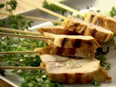 Ina Garten uses a combination of olive oil and freshly squeezed lemon juice for her moist and flavorful Grilled Lemon Chicken. For serving, you can skewer the cooked chicken with wooden sticks for your guests to grab.