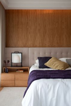 Modern bedroom decor, wood wall, modern furniture. Discover more bedroom decor ideas: www.bocadolobo.com/