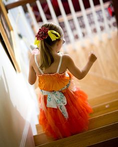 This bright flower girl sported a smart lace apron for flower petal storage!