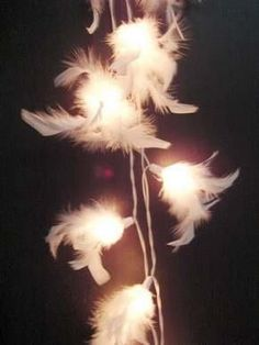 White feather light garland.  Ethereal!!  Just hot glue white feathers (or you could just wrap a white boa) around a string of white twinkle lights