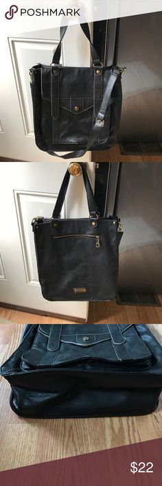 Steve Madden tote Steve Madden Black leather tote in good condition has a little bit of wear on the bottom edges. I can fit a laptop or basically anything u need for the day. It has a longer strap so u can use it as a cross body! Steve Madden Bags Totes