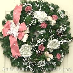Victorian Christmas Wreath - 2013 - Pink and white roses, pearls, doves and other charming decorations add a Victorian flourish to this lovely wreath. A pink and white bow is adorned with a faux lace butterfly for just the right touch. Our festive 'Victorian' Christmas Wreath will add a wonderful accent of old fashioned Victorian charm to your holiday decorating! - #ChristmasWreath #Wreaths #Wreath #ArtificialChristmasWreaths #Victorian #Christmas