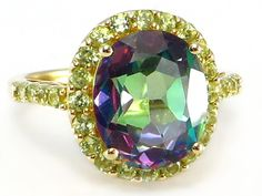 This season's trendy Multi Colored Gemstone Jewelry makes the perfect Holiday Gift:  Mystic Fire Topaz & Peridot Halo Ring set in 14k Yellow Gold   http://donnatsjewelry.com/Gold-Rings-Gemstone-Rings/c64_70/p4761/Mystic-Fire-Topaz-&-Peridot-Halo-Ring-14k-yellow-gold/product_info.html #mystic fire gemstone jewelry #mystic fire and peridot rings #multi colored gemstone jewelry #donnatsjewelry #November jewelry sales