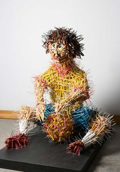 Cool Pencil Art by Federico Uribe...sculpture of a kid playing with a ball made of pencils