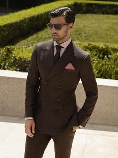 The six button double breasted suit was a design which originated in the 20s.