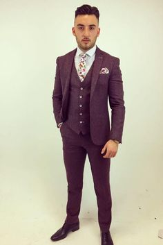 Soft Tweed Burgundy Suit By Remus. This limited edition Remus Uomo three piece suit just landed into us today. Exclusive to Ej Menswear in Sligo this light weight tweed is available in three colours with the Burgundy that Kaz is modelling here being the most eye catching.